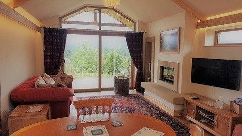 Comfortable lounge area with super wood burning fire. Willow View Cottage North Pennines Northumberland North East England