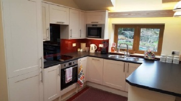 Open plan kitchen area at Willow View Cottage self catering near Hexham Northumberland North East England