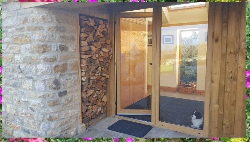 Entrance porch and under cover log store for Willow View Cottage